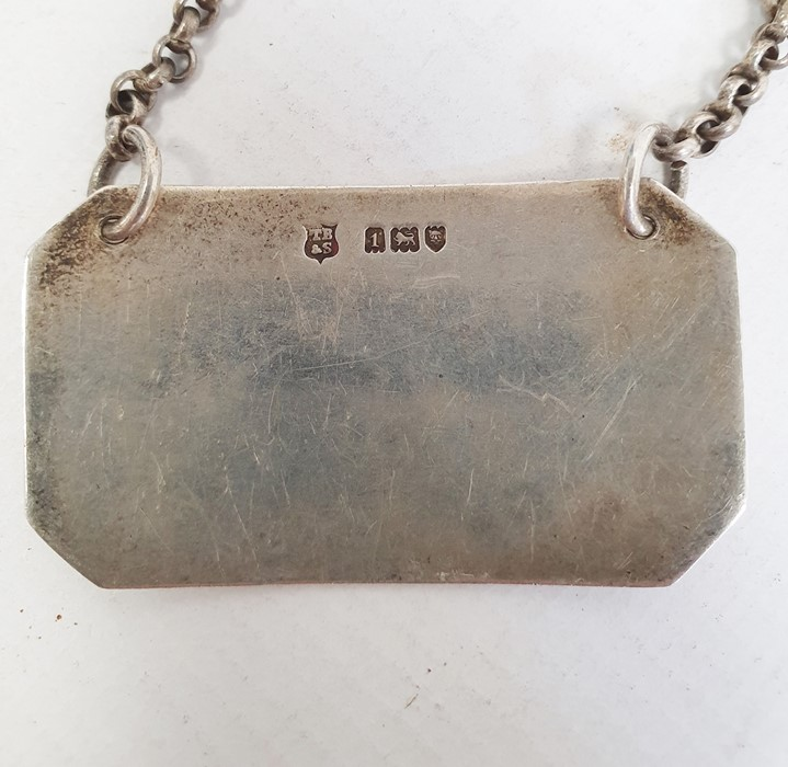 An early 20th century silver Whisky label, 0.5ozt. approx. a silver wine label, 0.9ozt. approx. - Image 3 of 4