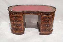 Early 20th century French-style ormolu-mounted rosewood kidney-shaped writing deskhaving brass