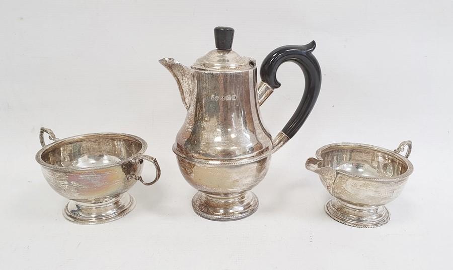 Three-piece silver tea set by Marson & Jones, Birmingham 1932 of circular form with bead borders