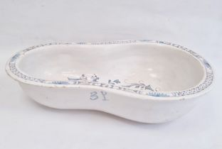 Nineteenth century tin-glazed earthenware bidet bowlin blue and white with floral scrolling