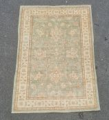 Pale green ground modern Eastern-style rugwith foliate decoration to the central field, cream