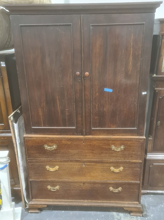 19th century oak linen press, moulded cornice with two cupboard doors enclosing open space (no