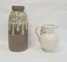 Clarice Cliff pottery jug having everted rim, pink and purple floral mounted and foliate scroll