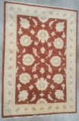 Modern Eastern-style red ground rugwith foliate decoration to the central field, cream ground