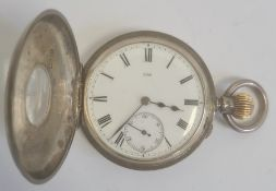 Silver half hunter pocket watch, the enamel dial with roman numerals and subsidiary seconds dial,