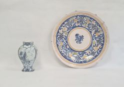 Delft inverse-baluster vase and a maiolica chargerwith stylised foliate spray to centre, blue