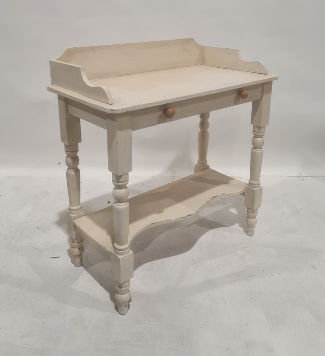 White painted three-quarter gallery washstand, the rectangular top with rounded corners, above