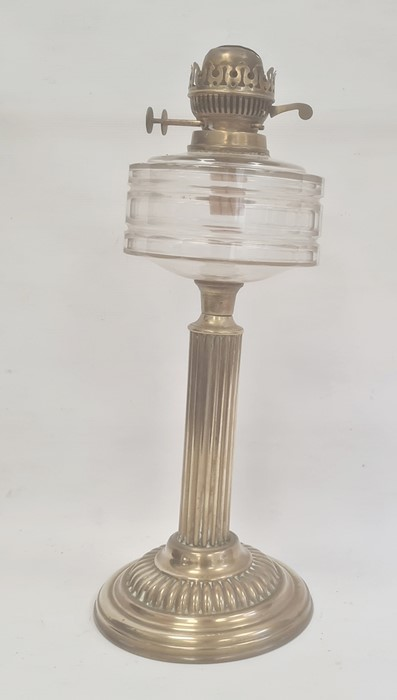 Old brass oil lamp with cut glass drum shaped well on reeded column and gadrooned circular base,