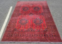 Modern Eastern-style red ground rugwith stepped border, 203cm x 195cm