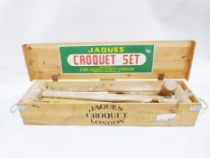 Modern Jaques croquet set in case and including additional child's croquet set (2)