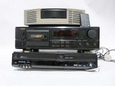 Bose radio alarm clock, a Denon cassette player and a Panasonic VHF player