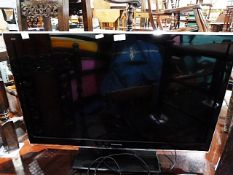 "Panasonic flatscreen TV, model no. TX-L32E5B, 32"" screen and the remote control"