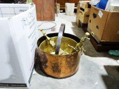 Copper coal scuttle, a brass jam pan, a pair of brass firedogs, copper jardinièreand various