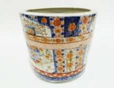 Large Japanese jardinere of barrel design painted in the Imari palette with panels of baskets of