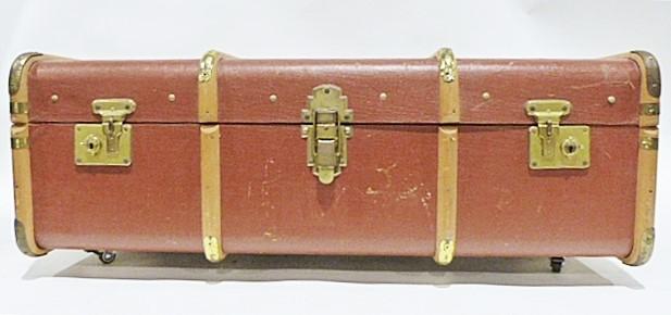Vintage wooden bound trunk with added castors