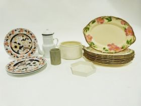 Two papier-mache model cars, a Harman/Kardon speaker system, various ceramics, household items