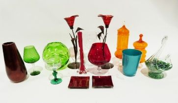 Quantity of coloured glass including a large orange glass goblet, a green glass swan vase, a metal