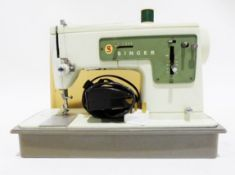 Hoover steam cleaner and a sewing machine (2)Condition ReportWe cannot confirm whether electronic