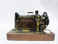 Singer sewing machine decorated with Egyptian style motifs, No. S7127435 in wooden case