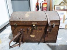 Vintage trunk with domed top and leather handles and straps, the locks bearing patent number and