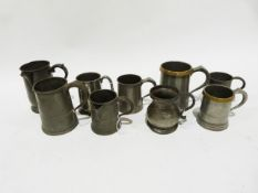 Quantity of pewter mugs, 19th century and later,one with engraved name and another with spout