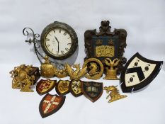 Double-sided vintage-style metal-framed clock, a carved wood armorial crest, assorted other gilt