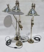 Three modern stainless steel cantilever table lamps(3)