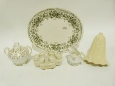 Two-handled Victorian sucrierwith gilt decoration, a set of six eggcupsin stand, an oval serving