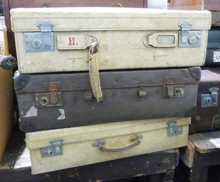Two vintage cream-coloured leather suitcases and another (3)