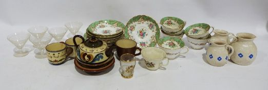 Tuscan china cups and saucers, the interior decorated with flowers and a green border, Devonware