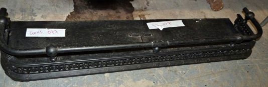 Cast iron fire curb painted black, 122cm long
