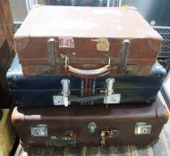 Brown suitcase with Royal Mail London Ltd label (torn), Orlean Paris label and two other