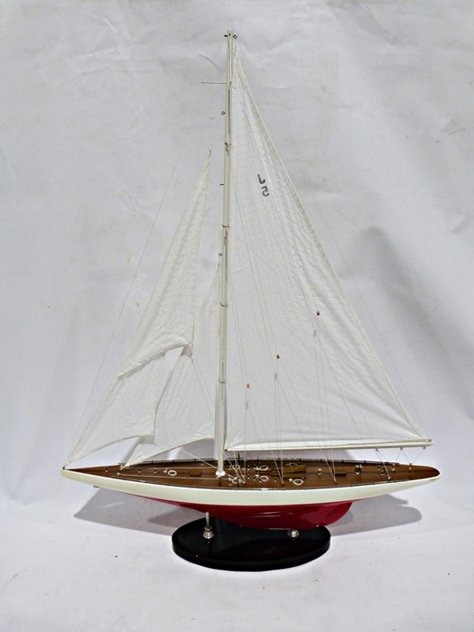 Modern pond yacht on a stand, single mast with rigging