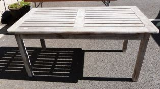Teak garden table, 75cm high, 65 cm width, 151 cm in lengthCondition ReportRevised Measurements
