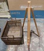 Two large wicker log/paper basketsand an easel