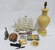 Plastic model of a galleon which lights up, a carved wooden cat asleep, another cat, boxed cards,