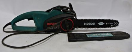 Chain saw, Bosch, a Black and Decker sander,boxed, and other assortedtools