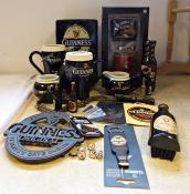 Collection of Guinness memorabilia to include boxed cups, socks and keyring, money box, teapot, a