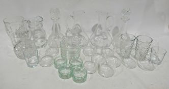 Quantity of assorted glassware to include water jugs, decanters, tumblers, bowls, a set of three