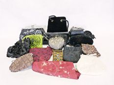 Three boxes of assorted handbags and purses