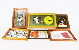 Five vintage Snoopy mirrors and a Snoopy mirrored clock