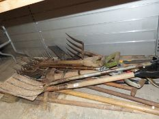 Large collection of garden tools to include four spades, pickaxe, etc
