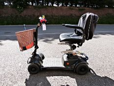 Ableworld motorised battery charged wheelchair with basket and walking stick