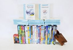 Box of various childrens DVDs and a set of Winnie the Pooh books