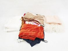 Quantity of textiles and clothingincluding a pair of orange velvet trousers, a paisley skirt, a