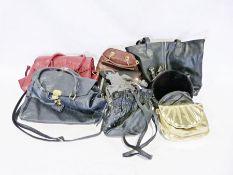 Three boxes of various handbags
