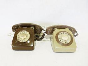 Two vintage telephones, one green and one brown (2)