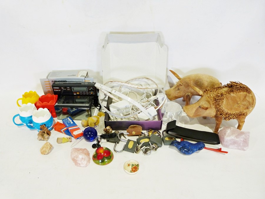 Box of various household items to include two wooden pig ornaments, a quartz radio, etc