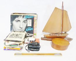 Two boxes of various toy cars and LPsto include LPs by Bruce Springsteen, Not the Nine O Clock