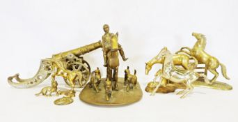 Two boxes of various brasswareto include a cannon, various horse sculptures, horse and hounds, etc